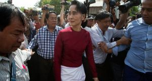 Burma's National League for Democracy party leader Aung San Suu Kyi visits a polling station outside Rangoon: She is barred from taking the presidency herself under the constitution written by the junta to preserve its power.  Photograph: Mark Baker/AP