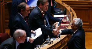 Socialist Party general secretary António Costa (right) shakes hands with Portuguese prime minister Pedro Passos Coelho in parliament after the government's programme was rejected. Photograph: Antonion Cotrim/EPA
