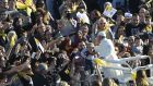 Pope Francis greets the crowd  in Florence, Italy. Photograph: Andreas Solaro/AFP/Getty Images