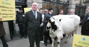 The president of the ICMSA Jackie Cahill with dairy farmers  outside Leinster House protesting about the collapse in milk prices. Photograph: Brenda Fitzsimons