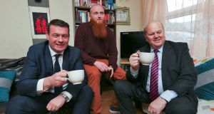 Minister for the Environment Alan Kelly and Minister for Finance Michael Noonan pictured with Eoin Whelan at his apartment in Phibsboro where they met with a couple who have benefitted from tenancy sustainment protocol. Photograph: Colin Keegan, Collins Dublin