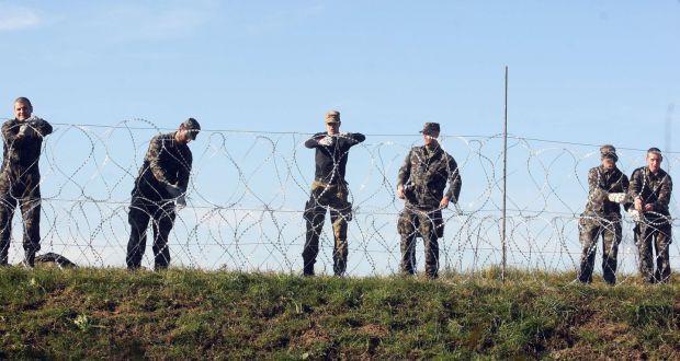 Slovenia begins to build razor-wire fence along border