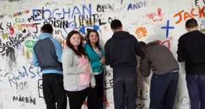 Leaving Cert Applied students from Edenderry College signing the Causey Farm wall in Navan during  an outing
