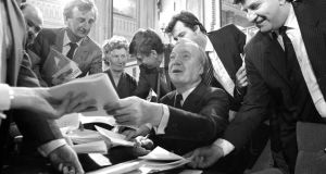 Fianna Fáil leader Charles Haughey signs copies of the New Ireland Forum's report in May 1984. Haughey initially opposed the subsequent Anglo-Irish Agreement. Photograph: Peter Thursfield