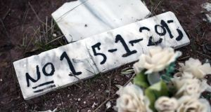 Burial place: Numbers and presumed dates of death are marked on rudimentary headstones for those drowned off the coast of Lesbos, where nearly 350,000 people have passed through this year. Photograph: Carl Court/Getty
