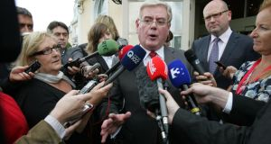 Eamon Gilmore answering reporters' questions at a special meeting of the Labour Party. Photograph: Frank Miller