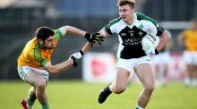 Killarney Legion's James O'Donoghue in action against South Kerry's Killian Young in the Kerry senior club football final. Photograph: Cathal Noonan/Inpho