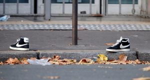 A pair of abandoned shoes seen left in the street near the Bataclan concert hall on Saturday  morning after a series of deadly attacks in Paris on Friday left an estimated 120 people dead. Photograph: Reuters