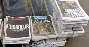 French newspapers are on display at a kiosk in Paris. Photograph: Pascal Le Segretain/Getty Images