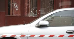 Bullet holes in windows of the Carillon bar, following the attacks in Paris. Photograph:  AFP