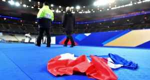 A French national flag lies on the ground in the stadium after the international friendly soccer match between France and Germany at Stade de Fance in Paris. Several people were killed in explosions outside the stadium. Photograph: EPA/Uwe Anspach