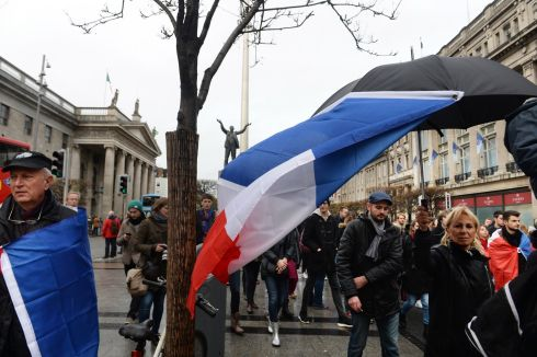 The French flag is flown as people march  from the Spire in O'Connell Street, Dublin to the Dail in solidarity with those  who died in the Paris  attacks. Photograph: Cyril Byrne: The Irish Times