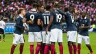 The French team celebrate a goal against Germany at the Stade France in Paris. Photograph: Getty Images