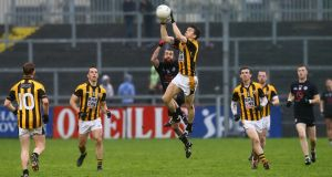 Kilcoo's Conor Laverty with Crossmaglen Rangers' Stephen Kernan. Photograph: Inpho
