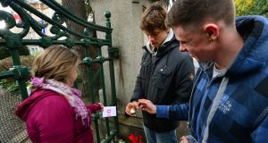 Sympathisers put a candle  outside the French ambassador's residence in Dublin. Ireland should not be shy about making its  experience and position known. Photograph: Dara Mac Dónaill