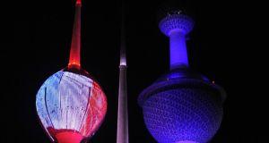 Kuwait City's landmark Kuwait Towers are illuminated in the colours of the French national flag yesterday. Photograph: Yasser al-Zayyat/AFP/Getty Images