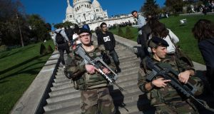 French soldiers stand guard at the Sacre-Coeur cathedral. Photograph:  David Ramos/Getty Images