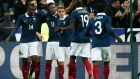 France players celebrate scoring the opening goal during the international friendly soccer match against Germany at the Stade de France. Photograph: Ian langsdon/EPA