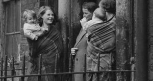 Mothers chatting at the entrance to a tenement building in Dublin, circa 1945. Photograph:  Hulton Archive/Getty Images