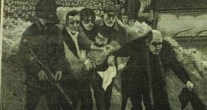 A mural depicting Fr Edward Daly running alongside marchers carrying an injured man on  Bloody Sunday that was  painted on a wall in the Bogside in Derry. File photograph: Frank Miller/The Irish Times