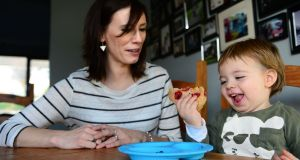 Aileen Cox Blundell with her son, Oscar, as he feeds himself pancakes at home in Swords, Dublin. Photograph: Dara Mac Dónaill