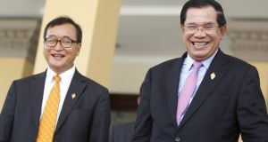 Cambodia's opposition leader Sam Rainsy  and prime minister Hun Sen: acrimony between the two threatens to plunge the country back into political conflict. Photograph: Samrang Pring/Reuters