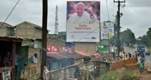 A poster welcoming Pope Francis to Kenya later this month: President Uhuru Kenyatta is under pressure to tackle Kenya's rampant corruption. Photograph: Tony Karumba/AFP/Getty Images