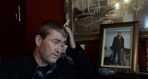 John Lynch in his home in Bray, Co Wicklow, with a framed photograph of his brother Jimmy who died in the Carrickmines fire where 10 perished. Photograph: Cyril Byrne/The Irish Times
