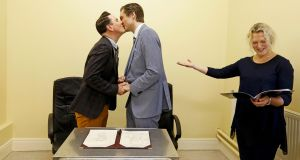 Richard Dowlin (L), 35, and Cormac Gollogly, 35, are married by registrar Mary Claire Heffernan in the South Clonmel Community Care Centre in County Tipperary on November , 17, 2015. Dowlin and Gollogly are the first gay couple to marry in Ireland. REUTERS/Cathal McNaughton