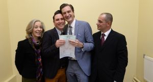Richard Dowling (second left) and Cormac Gollogly, smile after becoming the first same-sex couple to tie the knot under Ireland's new marriage equality legislation. Photograph: Dara Mac Donaill/The Irish Times