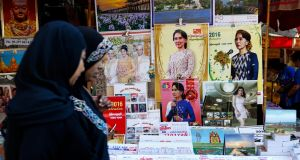 A  shop selling  calendars with the images of Burmese opposition leader Aung San Suu Kyi. People in Rangoon did not foresee that her party would win by  such a huge and decisive majority. Photograph: Lynn Bo Bo/EPA