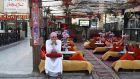 A cafe employee sits waiting for customers in Sharm al-Sheikh. Egypt's government held its weekly meeting in the Red Sea resort to show solidarity with a tourism industry hit by cancellations. Photograph: Asmaa Waguih/Reuters
