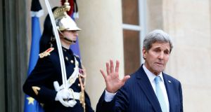 US secretary of state John Kerry on his way out of the Elysee Palace: welcomed the agreement. Photograph: AFP/Getty Images