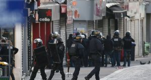Police  guard the site where a raid happened in the city centre of Saint Denis, near Paris. Photograph: EPA