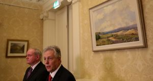 First Minister Peter Robinson (right) speaks alongside Deputy First Minister Martin McGuinness at Stormont Castle. Photograph: PA