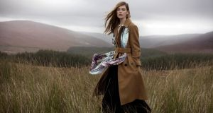 Above: camel trench coat, €675, Orla Kiely; printed silk scarf, €125, Susannagh Grogan; pleated black dress with collar, €295, Peter O'Brien
