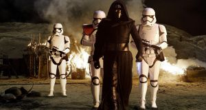 Star Wars: The Force Awakens. Kylo Ren (Adam Driver) with Stormtroopers. Photograph: David James/ Lucasfilm 2015