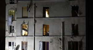 The building in the northern Paris suburb of Saint-Denis, where French Police special forces raided an apartment, hunting those behind the attacks that claimed 129 lives in the French capital five days earlier. Photogrraph: Eric Feferberg/AFP/Getty Images