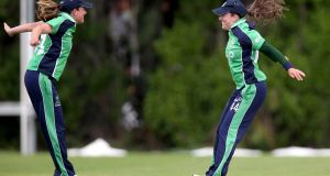 ICC Womens World Twenty20 Qualifier 3rd/4th Play-Off, YMCA Cricket Club, Dublin 1/8/2013Ireland vs NetherlandsIreland's Cecelia Joyce (right) celebrates taking a catch with Isobel JoyceMandatory Credit ©INPHO/Donall Farmer