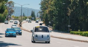 Google's self-driving car in Mountain View, California. The driverless car observes traffic laws to the letter.   Photograph: Gordon De Los Santos The New York Times.