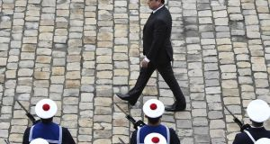 French president François Hollande reviews troops  in the courtyard of the Hotel des Invalides, Paris, yesterday. Photograph: Dominique Faget/AFP/Getty Images