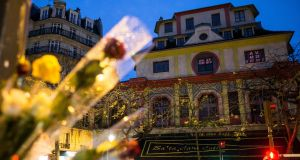 Roses adorn lamp-posts across the Bataclan concert venue, where terrorists killed 89 people in Paris. Photograph: Ian Langsdon/EPA