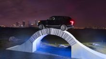 Range Rover drives over paper bridge to mark its  birthday