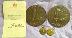 Two first World War medals, two next-of-kin memorial plaques, and a letter from Buckingham Palace