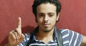 Suicide bomber: 20-year-old Bilal Hadfi, who blew himself outside the Stade de France, raising his right index finger in the Islamic State salute
