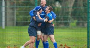 Ian Madigan, Hayden Triggs and Isaac Boss have some fun at Leinster squad training. Photograph: Morgan Treacy/Inpho