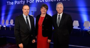 Nigel Dodds, Arlene Foster and party leader Peter Robinson  at the  annual DUP conference at the Lamon House hotel in Castlereagh on Friday. Photograph: Stephen Hamilton/Presseye