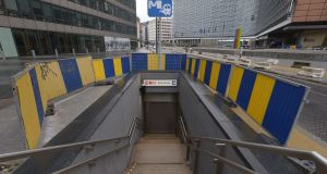 A photo shows a closed entrance of the Shuman Subway Station in Brussels on Saturday. Photograph: John Thys/AFP/Getty Images