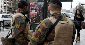 Belgian soldiers on the streets of Brussels on Saturday. Photograph: Francois Lenoir/Reuters