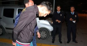 Ahmet Dahmani is escorted by a plain clothes police officer on Friday in Antalya. It is believed Dahmani scouted out the target sites for the attacks  in Paris a week ago. Photograph: Ihlas News Agency/AFP/Getty Images